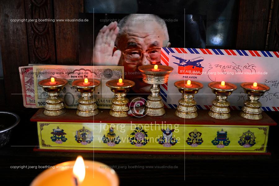 NEPAL Kathmandu, Lalitpur, tibetan refugee camp Jawalakhel, carpet factory JHC Jawalakhel Handicraft Center, image of Dalai Lama and butter lamps / NEPAL Kathmandu, Lalitpur, tibetische Fluechtlinge, tibetisches Fluechtlingslager Jawalakhel, Teppichfabrik JHC Jawalakhel Handicraft Center, Schrein mit Dalai Lama Bildnis und Butterlampen