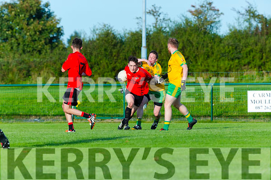 Paudie Clifford Fossa is tackled by Darren Brosnan Gneeveguilla during their Div 3 clash in Gneeveguilla on Friday evening