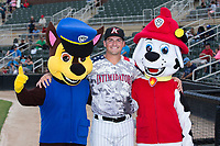 Kannapolis Intimidators manager Justin Jirschele (9) poses for a photo with the Paw Patrol prior to the game against the Delmarva Shorebirds at Kannapolis Intimidators Stadium on June 30, 2017 in Kannapolis, North Carolina.  The Shorebirds defeated the Intimidators 6-4.  (Brian Westerholt/Four Seam Images)