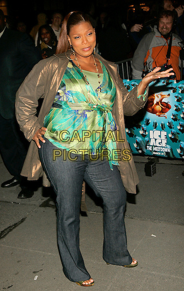 "QUEEN LATIFAH .The New York Premiere of ""Ice Age: The Meltdown""  at Ziegfeld Theatre, New York, NY, USA..March 28th, 2006.Photo: Jackson Lee/Admedia/Capital Pictures.Ref: JL/ADM.2 two full length bronze metallic jacket green top jeans denim hand .www.capitalpictures.com.sales@capitalpictures.com.© Capital Pictures."