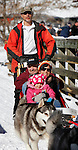 LEAD, SD - FEBRUARY 2, 2013:  Jack Christopher of Silent Run Adventures takes off with passengers Gary Linn and his daughter Kaylee Linn and granddaughter Bella Linn for a dogsled ride at the Kirk Trailhead on the Mickelson Trail south of Lead, S.D. Saturday February 2, 2013.  (Photo by Richard Carlson/dakotapress.org)s