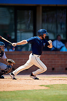 Mobile BayBears right fielder Forrestt Allday (5) follows through on a swing during a game against the Pensacola Blue Wahoos on April 26, 2017 at Hank Aaron Stadium in Mobile, Alabama.  Pensacola defeated Mobile 5-3.  (Mike Janes/Four Seam Images)