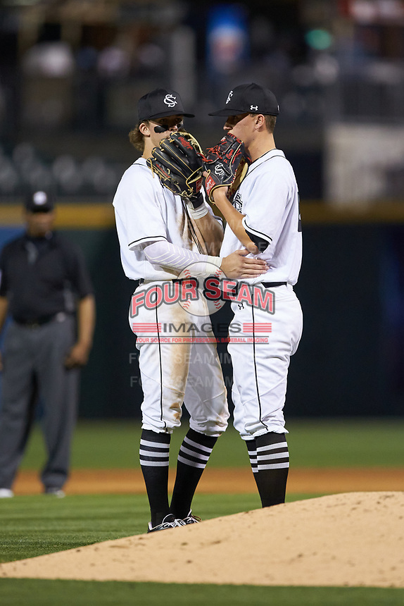 South Carolina Gamecocks L.T. Tolbert (11) and Parker Coyne (44) talk at the mound against the North Carolina Tar Heels at BB&T BallPark on April 3, 2018 in Charlotte, North Carolina. The Tar Heels defeated the Gamecocks 11-3. (Brian Westerholt/Four Seam Images)