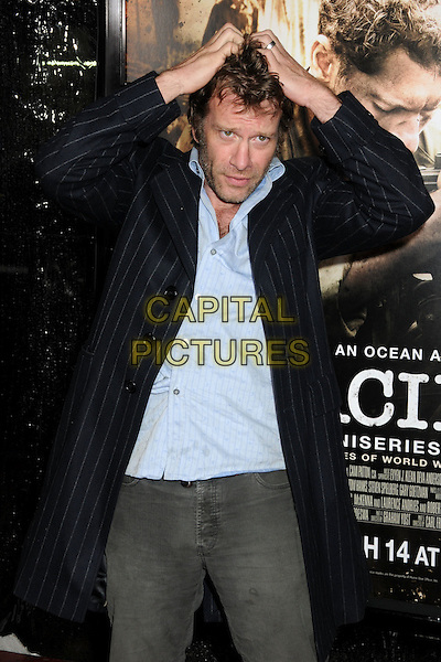 "THOMAS JANE.HBO's ""The Pacific"" Mini-Series Premiere held at Grauman's Chinese Theatre, Hollywood, California, USA..February 24th, 2010.half length shirt coat jacket hands on head in funny gesture blue black stubble facial hair pinstripe .CAP/ADM/BP.©Byron Purvis/AdMedia/Capital Pictures."