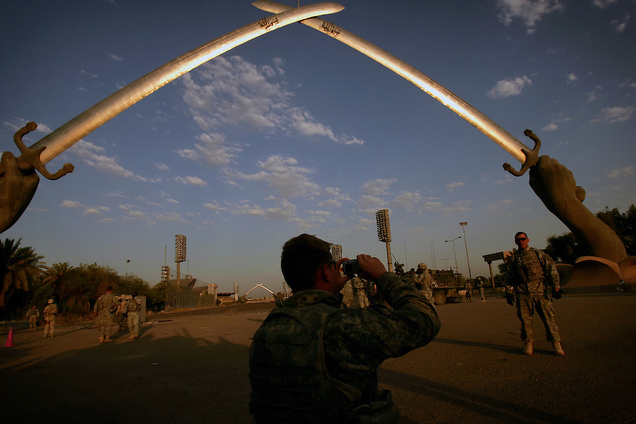 "Soldiers with the 4th Battalion 23rd Infantry Regiment 172nd Stryker Brigade play tourist under the Saddam-era ""Swords of Triumph"" monument in the Green Zone on Friday September 1, 2006. For most of the soldiers with the brigade, which was previously based in Mosul, this is their first time in Baghdad. The 172nd was extended at the last moment - with portions of the brigade already back in the States - when they were called upon to bolster security forces in Baghdad seeking to get a handle on a massive wave of sectarian killings in the Iraqi capital."