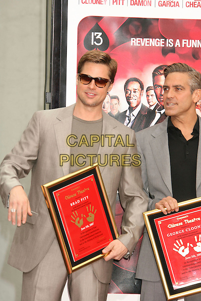 """BRAD PITT & GEORGE CLOONEY .""""Ocean's Thirteen"""" Handprint and Footprint Ceremony held  at Grauman's Chinese Theatre, Hollywood, California, USA..June 5th, 2007.half length grey gray beige suit jacket sunglasses shades plaque hand ring .CAP/ADM/RE.©Russ Elliot/AdMedia/Capital Pictures"""