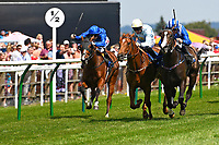 Neshmeya ridden by Jim Crowley blue/white cap and trained by Charles Hills start their run to win The Wateraid Mildren Construction Maiden Fillies' Stakes (Plus 10),  during Father's Day Racing at Salisbury Racecourse on 18th June 2017