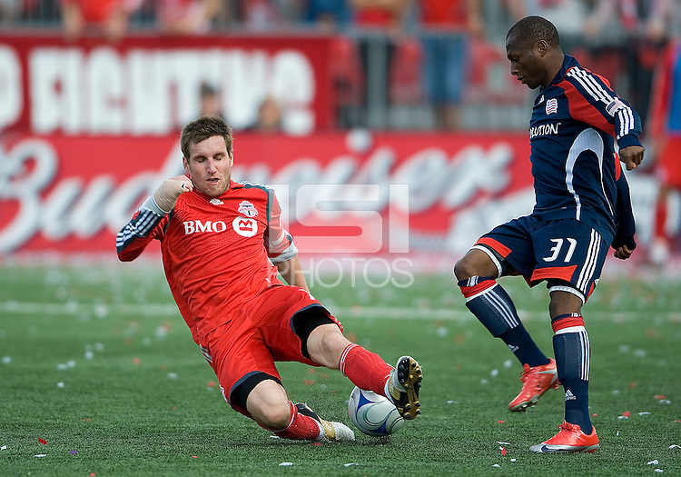 23 May 09: New England Revolution midfielder Sainey Nyassi #31 and Toronto FC midfielder Jim Brennan #11 in action during a game between the New England Revolution and Toronto FC..Toronto FC won 3-1.