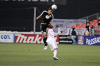 DC United defender Marc Burch (4) heads the ball against  New York Red Bulls forward Dane Richards (19)   DC United defeated the New York Red Bulls 2-0, at RFK Stadium ,Thursday June 4, 2009.