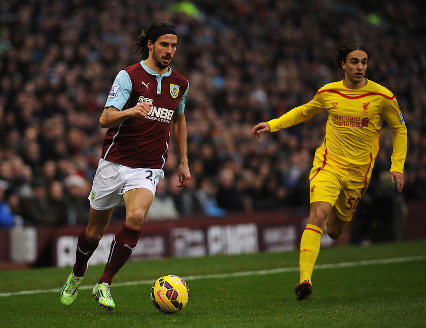 Burnley's George Boyd under pressure from Liverpool's Lazar Markovic<br /> <br /> Photographer Kevin Barnes/CameraSport<br /> <br /> Football - Barclays Premiership - Burnley v Liverpool - Friday 26th December 2014 - Turf Moor - Burnley<br /> <br /> &copy; CameraSport - 43 Linden Ave. Countesthorpe. Leicester. England. LE8 5PG - Tel: +44 (0) 116 277 4147 - admin@camerasport.com - www.camerasport.com