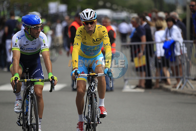 Yellow Jersey leader Vincenzo Nibali (ITA) Astana chats with Orica Michael Albasini (ITA) GreenEdge in Le Touquet for the start of Stage 4 of the 2014 Tour de France running 163.5km from Le Touquet to Lille. 8th July 2014.<br /> Picture: Eoin Clarke www.newsfile.ie