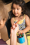 Education Preschool 2-3 year olds girl interacting with female teacher,looking at her as she talks
