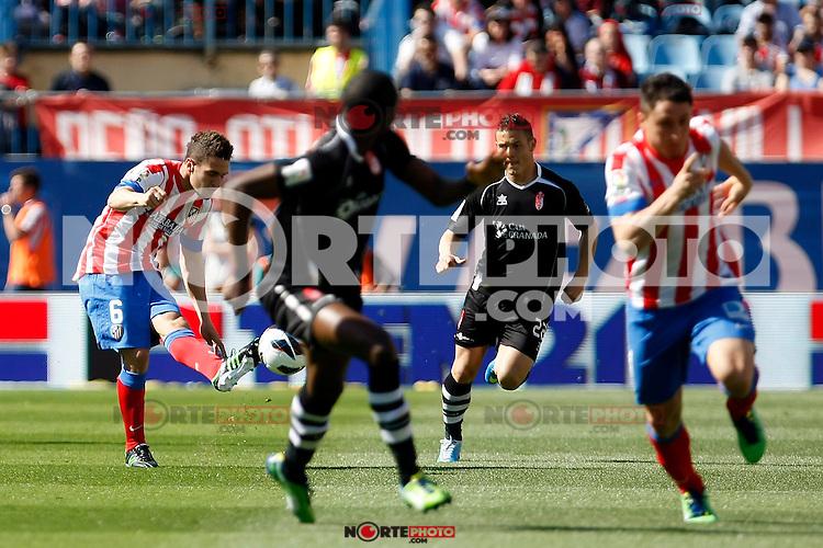 Atletico's Koke  and Granada's Torje during La Liga BBVA match. April 14, 2013.(ALTERPHOTOS/Alconada)