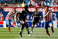 Atletico's Koke  and Granada's Torje during La Liga BBVA match. April 14, 2013.(ALTERPHOTOS/Alconada)