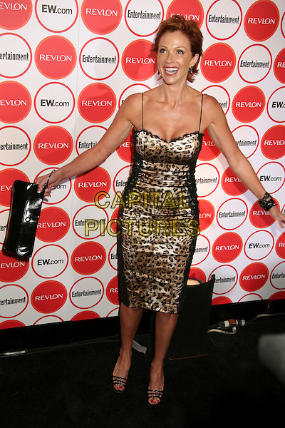 LAUREN HOLLY.Entertainment Weekly Magazine 4th Annual Pre-Emmy Party, Los Angeles, California, USA..August 26th, 2006.Ref: ADM/BP.full length leopard print dress clutch purse black arms.www.capitalpictures.com.sales@capitalpictures.com.©Byron Purvis/AdMedia/Capital Pictures.