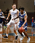 SIOUX FALLS, SD - MARCH 9:  Mikon Hewitt #13 of St. Thomas drives on Dylan Janecek #12 of Briar Cliff at the 2018 NAIA DII Men's Basketball Championship at the Sanford Pentagon in Sioux Falls. (Photo by Dick Carlson/Inertia)