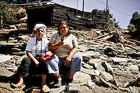 Chile, Aftermath of the tsunami in the area of Consitucion. Las hermanas Gómez Canales. Hipolita y Magali over their house in the litle port of Pellines.