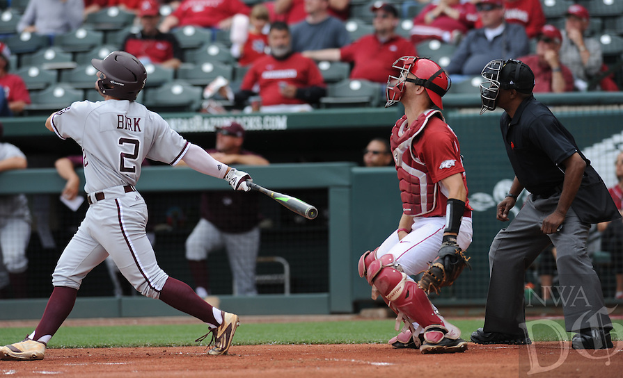 NWA Democrat-Gazette/ANDY SHUPE<br /> Arkansas catcher Tucker Pennell (right) watches as Texas A&amp;M second baseman Ryne Birk connects for a three-run home run Saturday, April 30, 2016, during the first inning at Baum Stadium in Fayetteville. Visit nwadg.com/photos to see more photographs from the game.