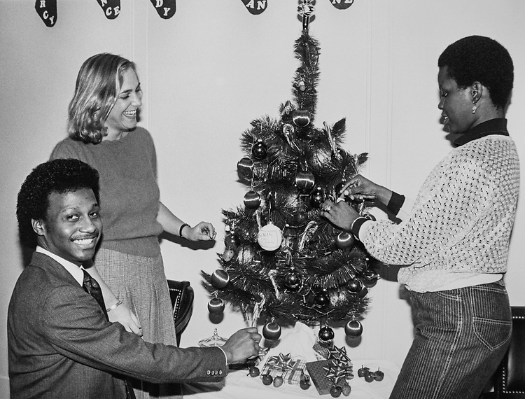 Staff members from Rep. Julian C. Dixon, D-Calif., office decorating Christmas tree during Christmas contest in 1983. (Photo by CQ Roll Call via Getty Images)