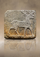 Photo of Hittite monumental relief sculpted orthostat stone panel from Water Gate Basalt, Karkamıs, (Kargamıs), Carchemish (Karkemish). 900-700 BC . Stag. Anatolian Civilisations Museum, Ankara, Turkey. With his large and many branched antler, he walks towards the right. <br /> <br /> On a brown art background.
