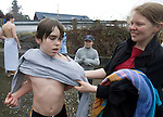 Stephanie Forsberg, (R) helps her son, Spencer Goodin, (L) with his sweatshirt after he participated in his first jump from a bridge in the 26th annual Polar Bear jump into the Burley Lagoon in Olalla, Washington on 1 January  2010. Over 300 hardy participants  braved the chilly lagoon waters to join in on the annual New Year's Day Tradition. Jim Bryant Photo. ©2010. ALL RIGHTS RESERVED.Bryant)................................................................