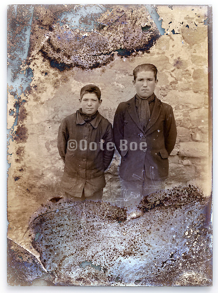 eroding glass plate with two farm workers