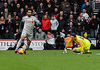 Liverpool's Mohamed Salah (left) battles past Bournemouth's Asmir Begovic (right) scores his side's fourth goal  <br /> <br /> Photographer David Horton/CameraSport<br /> <br /> The Premier League - Bournemouth v Liverpool - Saturday 8th December 2018 - Vitality Stadium - Bournemouth<br /> <br /> World Copyright © 2018 CameraSport. All rights reserved. 43 Linden Ave. Countesthorpe. Leicester. England. LE8 5PG - Tel: +44 (0) 116 277 4147 - admin@camerasport.com - www.camerasport.com