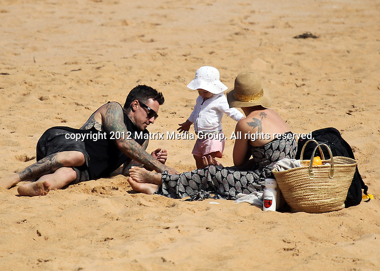 25 JULY.2012 BUNGAN BEACH SYDNEY AUSTRALIA ..NON EXCLUSIVE PICTURES..Singer Pink and her husband Carey Hart play on the sand at Bungan Beach with daughter Willow......*No internet without clearance*.MUST CALL PRIOR TO USE ..+61 2 9211-1088.Matrix Media Group.Note: All editorial images subject to the following: For editorial use only. Additional clearance required for commercial, wireless, internet or promotional use.Images may not be altered or modified. Matrix Media Group makes no representations or warranties regarding names, trademarks or logos appearing in the images.