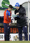 David Weir briefs Michael O'Halloran on tactics from his clipboard
