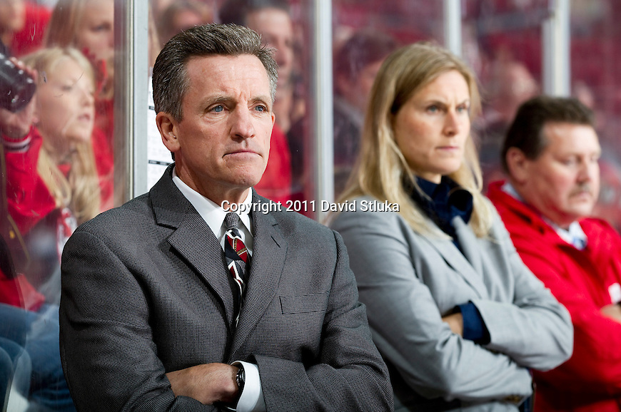 Wisconsin Badgers head coach Mark Johnson looks on during an NCAA Women's College Hockey game against Lindenwood University Lions on September 23, 2011 in Madison, Wisconsin. The Badgers won 11-0. (Photo by David Stluka)