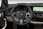 Car pictures of steering wheel view of a 2020 BMW 2-Series M-Sport 4 Door Sedan Steering Wheel