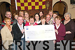 Walkers with Cheque: Members of the Duagh community who walked for charity, presenting a cheque for 5,696.56 to the Kerry Hospice in O'Brien's Bar, Duagh, on Friday night. (Front) Phil Meehan, Mike Carmody, Ann Sheehy, Mary O'Connor and Kay Hanley, Kerry Hospice. (Back row) Brendan Stack, Eileen Stack, BAnne OConnor, Valerie Collins, Aisling Collins, Niamh OConnor, Pat Sheehy, Peg Heffernan, Gabrielle OBrien and Ann Maloney..