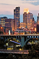 Minneapolis skyline at night as seen from the east.  Located on the banks of the Mississippi River, the Twin Cities are the sixteenth-largest metropolitan area in the United States.