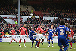 Nottingham Forest striker David McGoldrick attempting to win a header at the City Ground, Nottingham as Forest take on visitors Ipswich Town in an Npower Championship match. Forest won the match by two goals to nil in front of 22,935 spectators, with McGoldrick scoring the first goal.