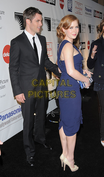 "JAMES MARSDEN & AMY ADAMS .at The 4th Annual ""A Fine Romance"" held at Sony Picture Studios in Culver City, California, USA,  November 08 2008.                                                                     .full length blue dress hand on hip clutch bag ruffles Christian Louboutin peep toe platform shoes black suit tie .CAP/DVS.©Debbie VanStory/Capital Pictures"