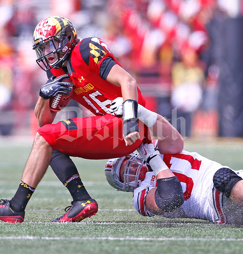 Ohio State Buckeyes defensive lineman Joey Bosa (97) gets a handle on Maryland Terrapins quarterback C.J. Brown (16) in the first half at Byrd Stadium on October 4, 2014.  (Chris Russell/Dispatch Photo)