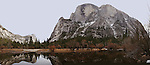 Winter scenes in Yosemite Valley located in the Yosemite National Park..Half Dome reflecting in Mirror Lake..This is an composite panoramic image made of three frames.