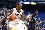 08 November 2013: UNCG's Tyrone Outlaw grab a rebound. The University of North Carolina Greensboro Spartans played the High Point University Panthers in a 2013-14 NCAA Division I men's college basketball game at the Greensboro Coliseum in Greensboro, North Carolina. UNCG won the game 82-74.