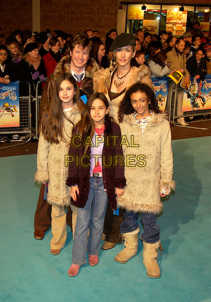 """LISA BUTCHER & FAMILY.""""Robots"""" UK Premiere of the animated film.Vue cinema,  Leicester Square.London 14  March 2005 .full length children brown leather fur coats hat boots.www.capitalpictures.com.sales@capitalpictures.com.©Capital Pictures"""