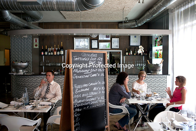 CAPE TOWN, SOUTH AFRICA - MARCH 22: Guests eat lunch at bizerca bistro on March 22, 2012 in Cape Town, South Africa (Photo by Per-Anders Pettersson)