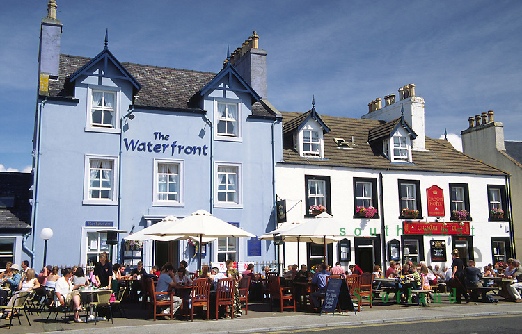 Seafront hotels Portpatrick people eating and drinking outside Galloway Scotland UK