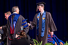 May 21, 2017; Former basketball and player Steve Vasturia receives his diploma from Dean Roger Huang during the Mendoza College of Business undergraduate Commencement ceremony, 2017. (Photo by Matt Cashore/University of Notre Dame)