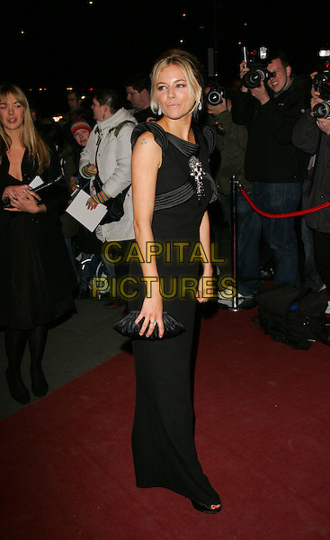 SIENNA MILLER?28th Annual London Film Critics Circle Awards held at the Grosvenor House Hotel, Park Lane, London, England,  February 8th 2008..full length black dress brooch beads clutch bag.CAP/ROS.?Steve Ross/Capital Pictures