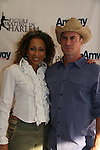 Law & Order SVU's Tamara Tunie (As The World Turns) & Christopher Meloni at Skating with the Stars (celebrities & Olympic skaters), a benefit gala for Figure Skating in Harlem on April 6, 2010 at Wollman Rink, Central Park, New York City, New York. (Photo by Sue Coflin/Max Photos)