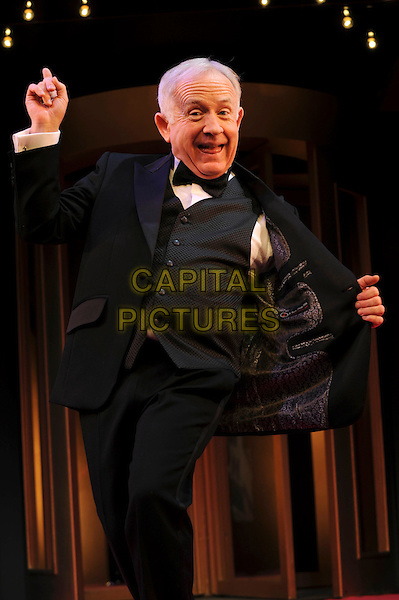 "LESLIE JORDAN.Photocall for ""My Trip Down The Pink Carpet"" Apollo Theatre, London, England..January 26th, 2011  .stage half length  black waistcoat trousers hand opening jacket lining.CAP/IA.©Ian Allis/Capital Pictures."