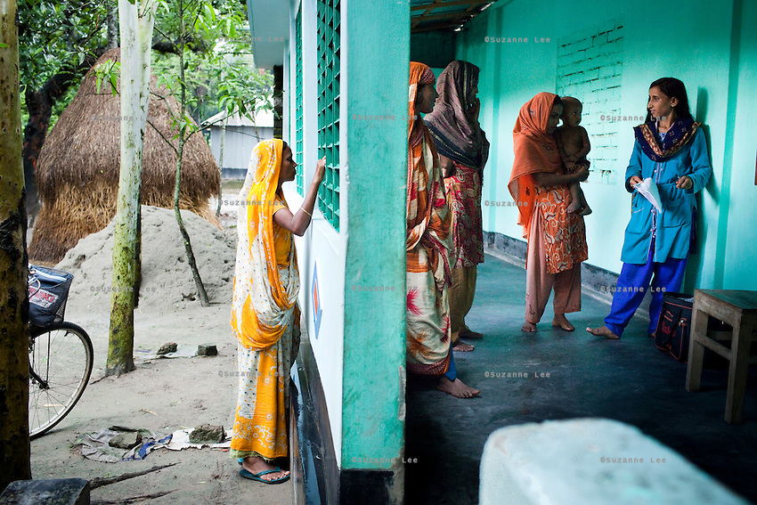Jesmin Akhter, 26 (right, in turquoise & blue), sells her products in one of her 'marketplaces', Jerai Villlage, Gobindagonj Upazila, Gaibandha, Bangladesh on 19th September 2011. She has found financial independence and contributes to her household income by working as a saleswoman, earning 3500 - 5000 Bangladeshi Taka per month. She is the top saleswoman under her 'hub', out of 30 women. Having worked for about 2.5 years, she cycles from village to village and door to door in a country where women on bicycles is an extremely uncommon sight. She is one of many rural Bangladeshi women trained by NGO CARE Bangladesh as part of their project on empowering women in this traditionally patriarchal society. Named 'Aparajitas', which means 'women who never accept defeat', these women are trained to sell products in their villages and others around them from door-to-door, bringing global products from brands such as BATA, Unilever and GDFL to the most remote of villages, and bringing social and financial empowerment to themselves.  Photo by Suzanne Lee for The Guardian