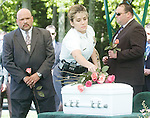 The Gazette. Spokeswomen of the Prince Geroge's County Police Captain Mistinette Mints lays a rose down on the casket of Mary Rose Darerca during her funeral at Resurrection Cemetery in Clinton on Friday morning. Mary Rose Darerca was found by two fisherman dead in a bag in Lake Artemisia in Berwyn Heights on March 22nd. Waiting to lay their roses are Senior Detective Bernard Nelson, left and Detective M. Barnhardt, right both of the Prince George's County Police Department homicide unit. .