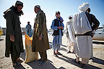 Mcc0018106 . SundayTelegraph..For the Sunday Telegraph..Afghans at a wheat distribution point adjacent to British base Fob Shawqat in the Nad e'Ali district of Helmand province, southern Afghanistan...Afghanistan 10 November 09