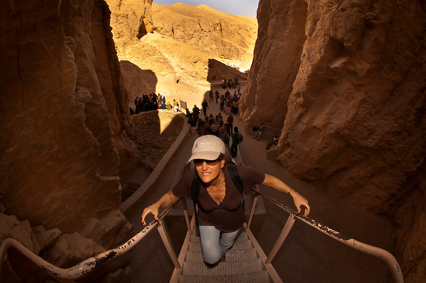 Tourists walking up to the entrance of the Tomb of Menophis II, Valley of the Kings Archaeological site, near Luxor, Egypt
