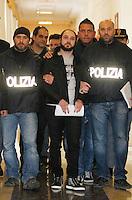 Mario Riccio boss di del clan pagano Amato di Scampia  scortato dagli agenti di polizia dopo il suo arresto<br /> <br /> Police arrested a fugitive Camorra mafia boss  Mario Riccio, known as 'Mariano of Scampia <br /> Riccio is the youngest fugitive   on the Italian Interior Ministry's list of the 100 most dangerous fugitives still in circulation Mario Riccio boss di del clan pagano Amato di Scampia  scortato dagli agenti di polizia dopo il suo arresto<br /> <br /> Italian police officiers lead  Camorra mafia boss  Mario Riccio, <br /> Riccio is the youngest fugitive   on the Italian Interior Ministry's list of the 100 most dangerous fugitives still in circulation